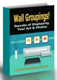 arranging art on a wall, wall decor, decorating with art